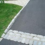 Belgium Block Pavers Edging a Driveway